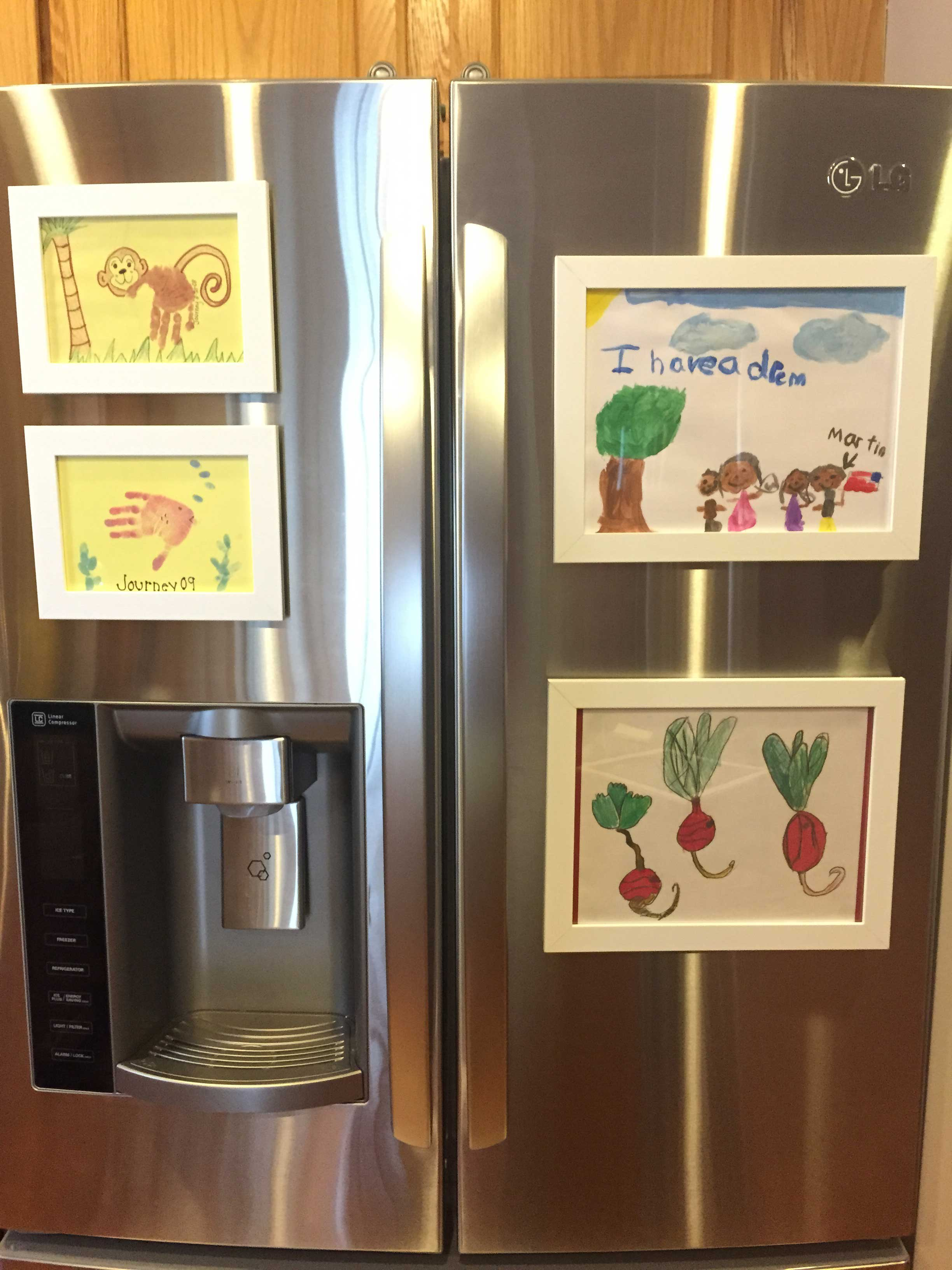 8 creative ways to display your kid s art her life inspired - Simple ways of keeping your home organized using magnetic picture frames ...